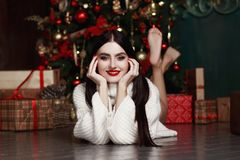 Beautiful girl lying by the tree. Gifts, new year. Stock Image