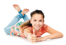 Beautiful girl lying on white floor Stock Photo