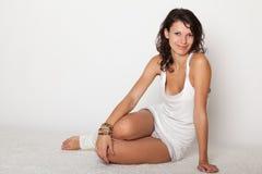 Beautiful girl lying in white underwear Stock Photography