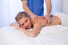Beautiful girl make therapeutic massage in the Spa. 1 Stock Image