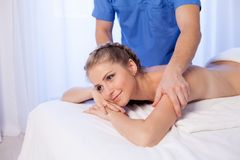 Beautiful girl make therapeutic massage in the Spa. 1 Royalty Free Stock Photos
