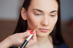 Beautiful girl make-up applied. Royalty Free Stock Image