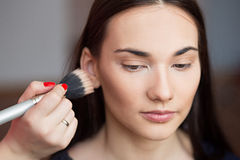 Beautiful girl make-up applied. Royalty Free Stock Photos