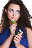 Beautiful girl with a make-up brush Royalty Free Stock Images