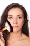 Beautiful girl with a make-up brush Stock Photo