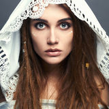 Beautiful girl with make-up,dreadlocks and lace shawl Stock Photography