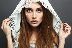 Beautiful girl with make-up,dreadlocks and lace shawl Royalty Free Stock Photography