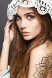 Beautiful girl with make-up,tattoo and lace shawl Royalty Free Stock Photo