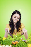 Beautiful girl makes fresh vegetables salad Stock Photography