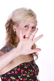 Beautiful Girl Makes a Hand Gesture Royalty Free Stock Images