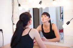 Beautiful girl makes herself the makeup Stock Photos