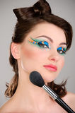 Beautiful girl makes a makeup Royalty Free Stock Photography
