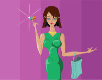 Beautiful girl is shopping shopping. Beautiful girl makes a purchase with a credit card Royalty Free Stock Photos