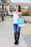 Beautiful girl makes selfie in a shopping centre Stock Photography
