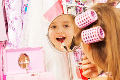 Beautiful girl makes up her face looking in mirror Royalty Free Stock Photos