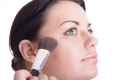 Beautiful girl with makeup brush royalty free stock photos