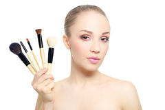 Beautiful girl with makeup brushes isolated on white Stock Image