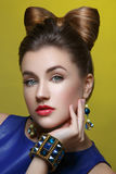 Beautiful girl with makeup and hair bow Royalty Free Stock Image