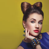 Beautiful girl with makeup and hair bow Royalty Free Stock Photos