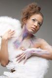 Beautiful girl in makeup keeps angel wings Stock Photos