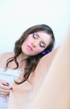Beautiful girl with makeup in a white cloth with fabrics Stock Image