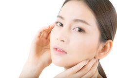 Beautiful girl with makeup, woman and skin care concept / attractive asia girl smilling on face isolated. On white background royalty free stock images