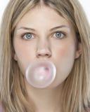 Beautiful Girl Making A Bubble Royalty Free Stock Image