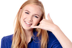 Beautiful girl making a Call Me sign Stock Image