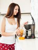 Beautiful girl making coffee royalty free stock photography