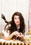 Beautiful girl making manicure Royalty Free Stock Photography
