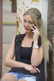 Beautiful girl making phone call. Outside stock photo