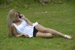Beautiful girl making phone call. In park Royalty Free Stock Photography