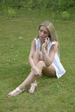 Beautiful girl making phone call. In park royalty free stock image