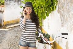 Beautiful girl making a phone call Stock Photos