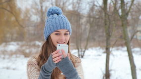Beautiful girl making selfi in Winter Park stock video footage