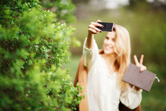 Beautiful girl making selfie  in  blossom garden on a spring day Stock Images