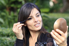 Beautiful girl making up her eyes Stock Images
