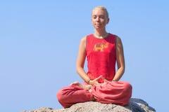 Beautiful girl making yoga exercise Stock Photos