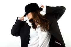 Beautiful girl in a man's hat Stock Images