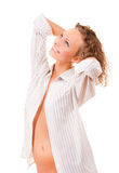 Beautiful girl in a man's shirt wakes up Royalty Free Stock Images
