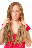 Beautiful girl many plaits hairstyle holding hair Stock Photo