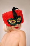 Beautiful girl in mask Stock Images