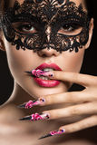 Beautiful girl in mask with long nails and sensual Royalty Free Stock Images