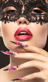 Beautiful girl in mask with long nails and sensual Stock Photo