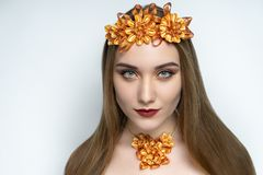 Beautiful girl, massive gold accessory necklace, matte vine lipstick royalty free stock photography