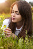 Beautiful girl in a meadow in the morning Stock Photo