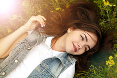 Beautiful girl in a meadow in the morning Stock Photography
