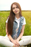 Beautiful girl in a meadow in the morning Royalty Free Stock Photos