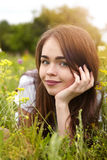 Beautiful girl in a meadow in the morning Stock Photos