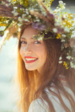 Beautiful girl in meadow in national suite Stock Photo